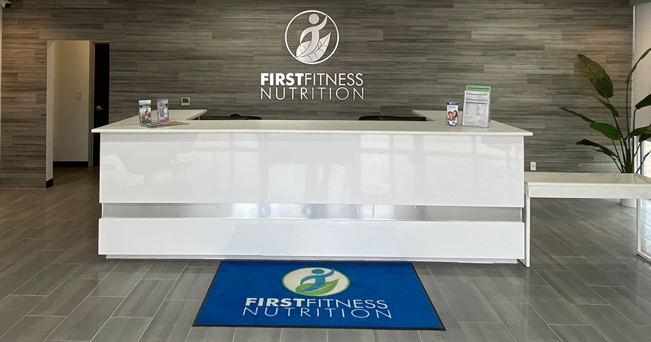 FirstFitness Nutrition lobby with desk and logo on the wall